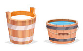 Wooden bucket with water and milk