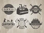 Woodworks symbols. Vector badges for carpentry, sawmill, lumberjack service or woodwork shop. Set of hand tools labels on vintage wooden background.