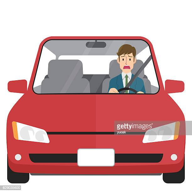 Worried man driving
