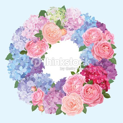 Wreath of hydrangea flowers and pink roses with blue background.