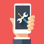Wrench and screwdriver icon on smartphone screen. Hand holding smartphone. Fix, maintenance, mobile phone repair service concept for web banner, web site, infographics. Flat design vector illustration