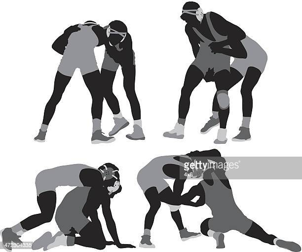 Wrestlers in action