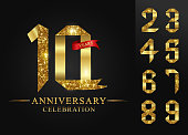 10 anniversary celebration and 0-9 numbers gold ribbon foil on black background.