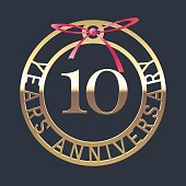 10 years anniversary vector icon, symbol. Graphic design element or logo with golden medal and red ribbon for 10th anniversary