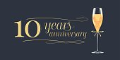 10 years anniversary vector icon. Graphic design element, banner with golden lettering and glass of champagne for 10th anniversary background