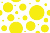 Seamless pattern of yellow circles of different sizes. Vector abstract background