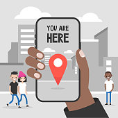You are here. Navigation in the city. Black hand holding a mobile phone. Technologies. Flat editable vector illustration, clip art