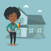 Happy african-american homeowner showing key to a new house. Young smiling real estate agent with key standing on the background of house. Vector cartoon illustration. Square layout.