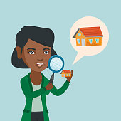 Young african-american smiling woman looking for a new house in real estate market. Happy woman using a magnifying glass to look closer at the house model. Vector cartoon illustration. Square layout.