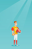 Young caucasian rugby player holding a ball and a helmet in hands. Full length of rugby player in uniform. Sport and leisure concept. Vector flat design illustration. Vertical layout.