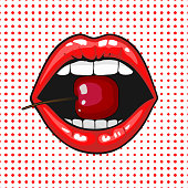 Close up view of young pretty woman lips portrait biting a cherry. Open month with white teeth eating a red cheery. halftone dots background. Pop art comic style