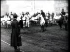 Military parade on Red Square crowd cheering Joseph Stalin looking at parade / Moscow Russia