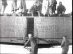 MONTAGE 'All was sent to the front' Civil war Armoured car Red Army soldiers walk on railroad tracks load munitions on train get on the train...
