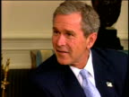 13Nov2001 MONTAGE Vladimir Putin sitting w/ George W Bush in the White House They shake hands Press standing around couches Walking outside together...