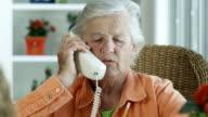 ELDERLY WOMAN ON PHONE-1080HD