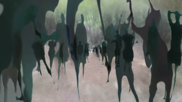 HUMAN SHAPES. WALKING ALONG AN OLD ALLEY IN RURAL DALMATIA.