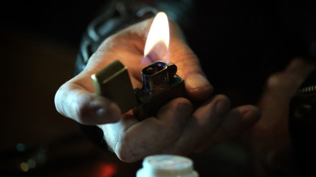 CU SHOT OF MAN WITH LIGHTER HD