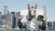 'MS, Lockdown, Businessman wearing a donkey mask and showing off with cash, New York City, USA'