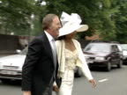 Bruce Forsyth and his wife pose for photographers as they make their way to Royal Ascot for Ladies Day 1989