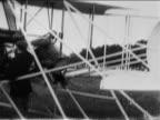 Orville Wright Lt Frank Lahm sitting in airplane before flight / documentary