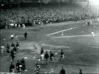 B/W 1921 high angle wide shot crowd storming clubhouse after Yankees win pennant / documentary