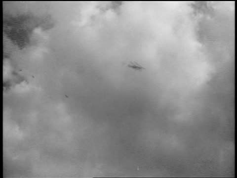 B/W 1939 low angle German fighters swooping down in sky over Warsaw Poland / documentary