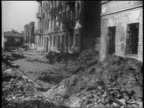 B/W 1939 shelled buildings on city street after German bombings / Warsaw Poland / documentary