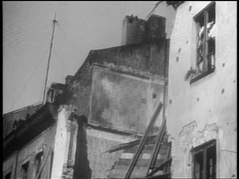 B/W 1939 tilt down bombed building rubble after German invasion / Warsaw Poland / documentary