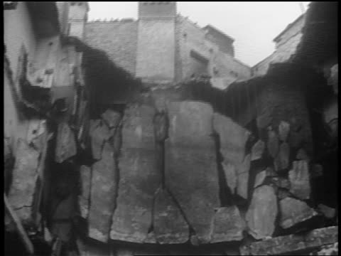 B/W 1939 close up bombed building after German invasion / Warsaw / documentary