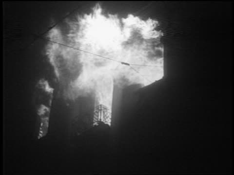 B/W 1939 low angle building burning at night after German bombing / Warsaw Poland / documentary