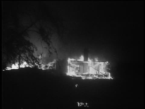 B/W 1939 long shot burning buildings after German bombing / Warsaw Poland / documentary