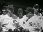 B/W 1930s Yankees manager Joe McCarthy shaking hands with Lou Gehrig / other players in background
