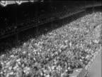B/W 1955 high angle long shot PAN tilt up crowded Yankee Stadium / World Series / Yankees vs Dodgers