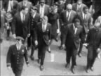 B/W 1968 high angle Robert Kennedy marching in funeral procession of Martin Luther King / newsreel