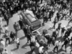 B/W 1968 crowd marching with casket in funeral procession of Martin Luther King / newsreel