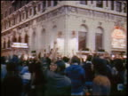 VIEW crowd raising arms at antiwar protest on street / Chicago / newsreel