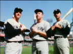 1964 low angle Yankees Roger Maris Mickey Mantle Joe Pepitone posing with bats on field / industrial
