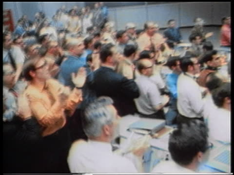 1970 crowd of men clapping in mission control after Apollo 13 spacecraft landing