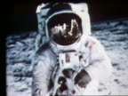 zoom out of still of astronaut on Moon