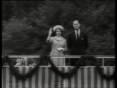 B/W Queen Elizabeth and Prince Philip waving from riverboat in Germany / 1960's / SOUND
