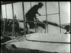 Wright brothers preparing for flight