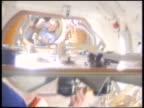 Astronaut Wetherbee unlocking hatch of space shuttle greeting Mir cosmonaut Solvyev / STS86