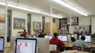 High School Students Using Apple Computers