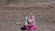 ATTRACTIVE WOMAN SUNBATHING ON BEACH