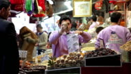 SWEET SELLER AND STALL AT SPICE BAZAAR