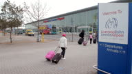 PEOPLE WALKING AT LIVERPOOL AIRPORT