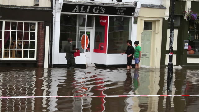 FLOODWATER COVERS TOWER STREET AND FLOODS PROPERTIES CITY OF YORK