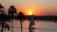 FELUCCA AND FERRY AT SUNSET