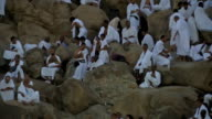 MECCA PILGRIMS STANDING ON ARAFAT MOUNTAIN