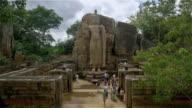 AUKANA BUDDHA STATUE AND TOURISTS